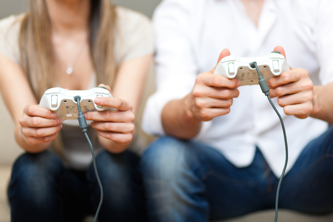 Couple playing at videogames
