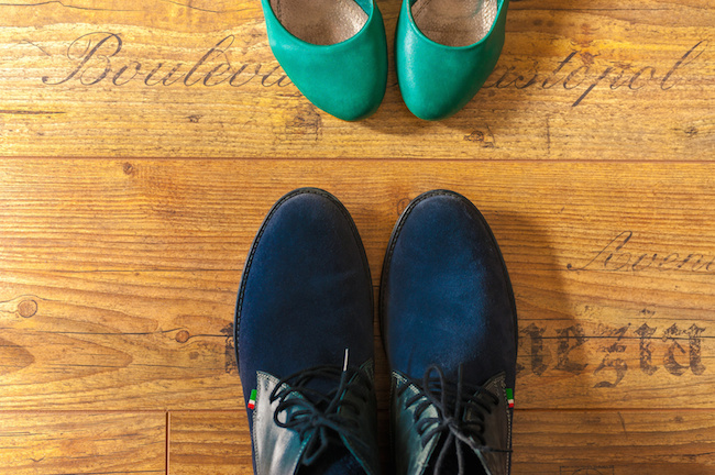 Man and woman leather shoes view from above wood floor