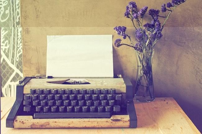 vintage typewriter on the wood texture