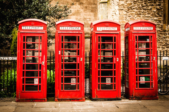 Row od british red telephone boxes