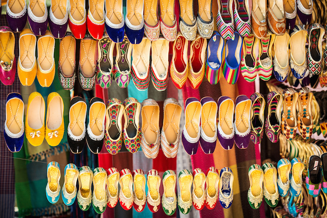 Colorful ethnic handmade shoes on flea market in India