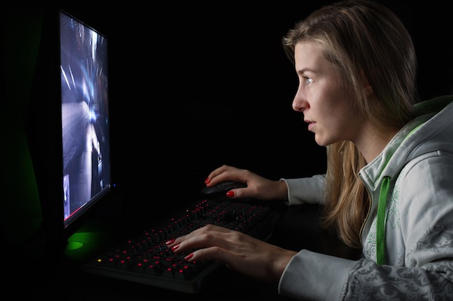 Gamer girl playing a first person shooter