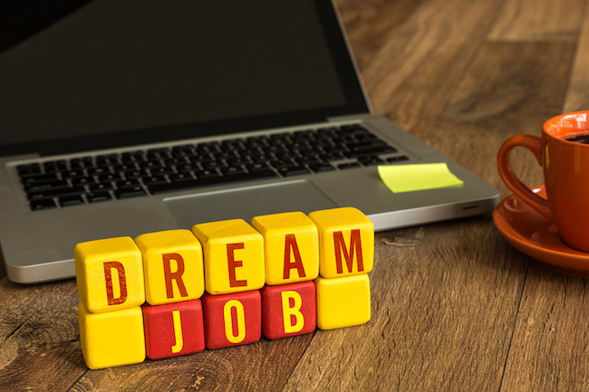 Dream Job written on a wooden cube in a office desk