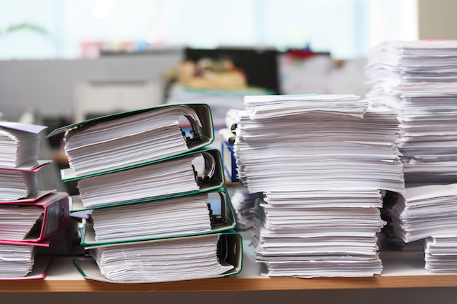 Close up stack of paper on the office desk