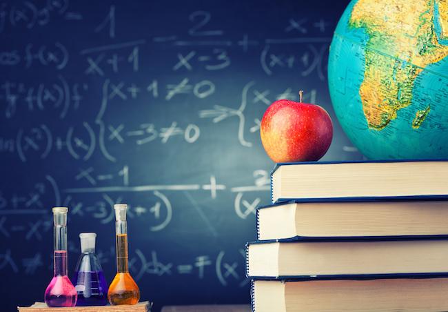 school concept apple book and blackboard