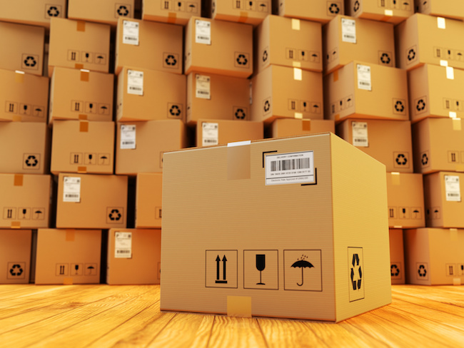 Distribution warehouse, package shipment, freight transportation and delivery concept, cardboard box and stack of parcels behind it on wooden floor in the retail store building